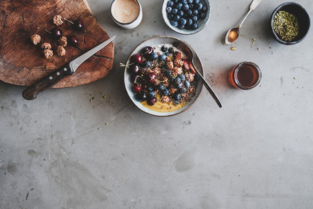 Healthy breakfast with granola yogurt bowl with fruits and coffee
