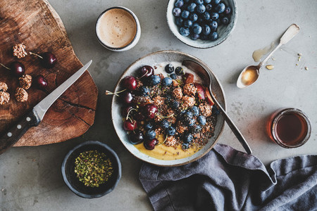 Quinoa oat granola with fruits  honey and cup of coffee
