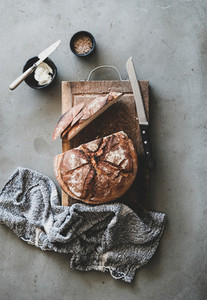 Bread and butter breakfast or snack over concrete background