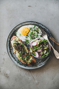 Healthy trendy breakfast plate over grey concrete background