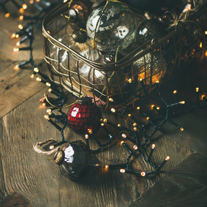 Christmas decoration balls in box and light garland  square crop