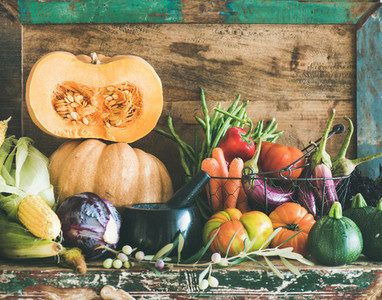 Assortment of various Autumn vegetables for healthy cooking on cupboard