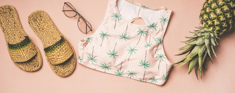 Variety of summer apparel fashionable items and pinapple  wide composition