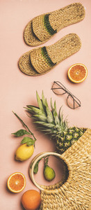 Summer apparel set and fruits over pink background  vertical composition