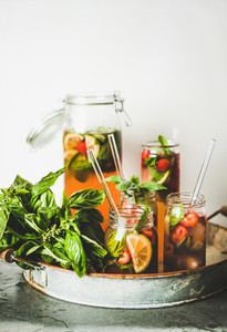 Fresh strawberry and basil lemonade or iced tea in glasses