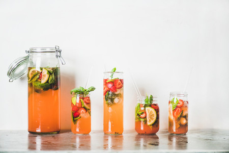 Fresh homemade strawberry and basil lemonade in tumblers  copy space