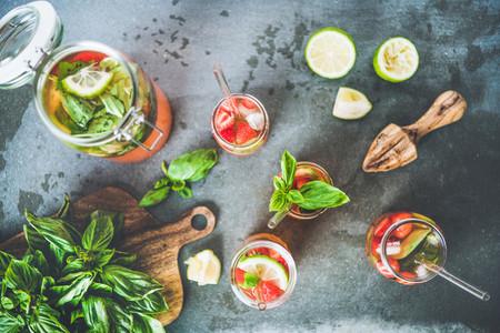 Fresh homemade lemonade or iced tea with strawberry and basil