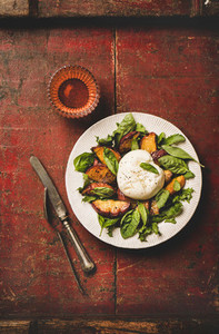 Salad with burrata cheese and peaches and rose wine