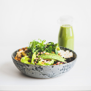 Healthy vegan superbowl with vegetables and green smoothie  square crop