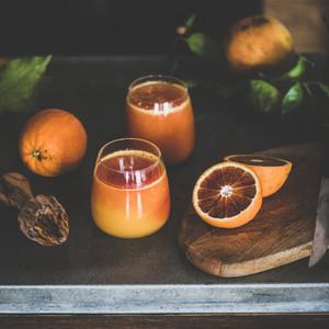 Two glasses of blood orange juice or smoothie  square crop