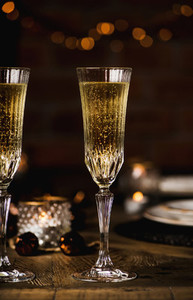 Christmas or New year festive table set with champagne