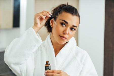 Beautiful woman using serum