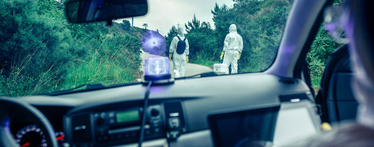 View from inside the car of people in bacteriological protection