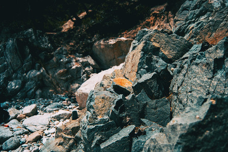 Close up of a pile of steep gray rocks