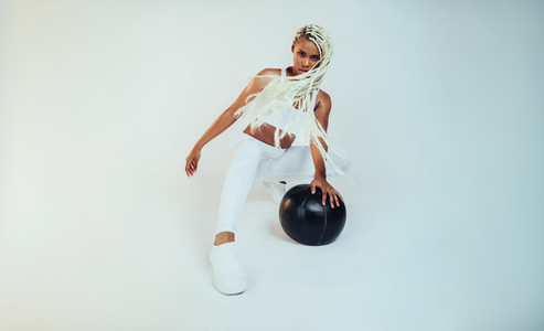 African american female athlete working out using medicine ball
