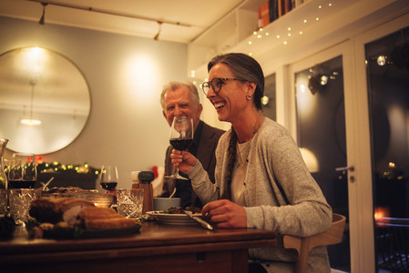 Senior couple enjoying having christmas dinner with family