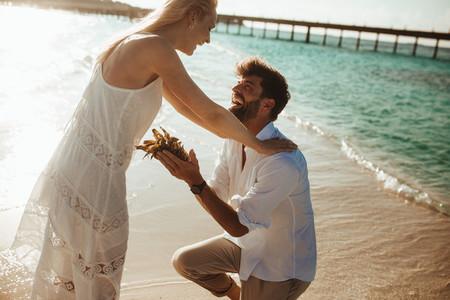 Tourist couple having fun at an exotic beach destination