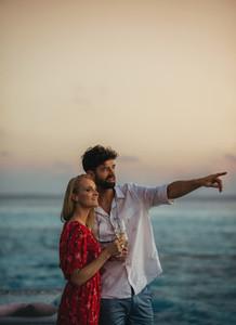 Romantic couple near the sea at sunset