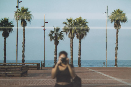 Girl reflection and palms
