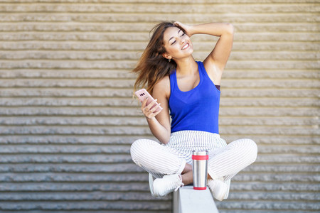 Girl drinking from a metal water bottle wearing casual clothes