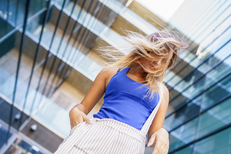 View from above of young girl moving her hair wild