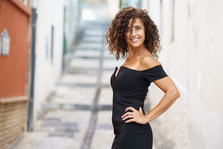 Beautiful brunette middle aged woman wearing dress outdoors