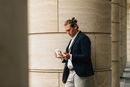 Businessman with takeaway coffee