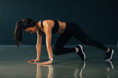 Muscular woman wearing wireless