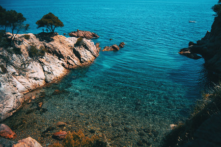 Seascape of a beautiful small cove with shallow crystalline waters