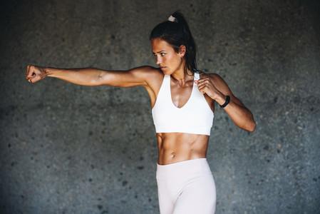 Sportswoman doing shadow boxing exercise