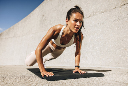 Fitness woman doing wide mountain climbers exercise