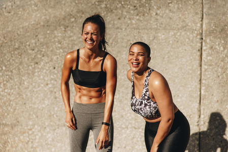 Fitness women smiling after workout session