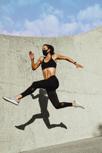 Woman in sportswear running and jumping