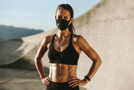 Fitness woman wearing protective face