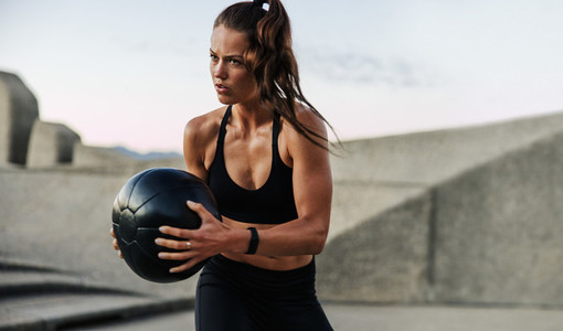 Fitness woman exercising with medicine ball