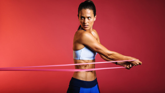 Fitness woman training with resistance bands