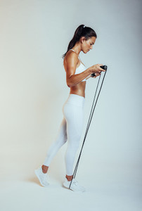 Portrait of a fitness woman with skipping rope