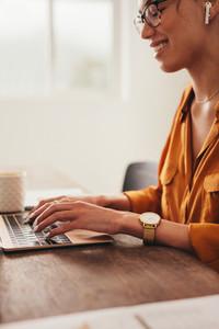 Female blogger writing a blog on laptop