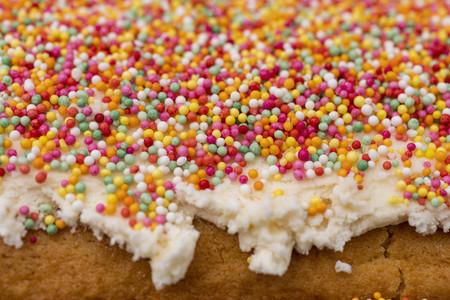 Close up multicolor sprinkles on cake frosting