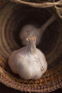 Close up garlic bulb in basket