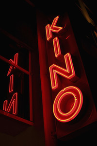 Neon red movie theater sign