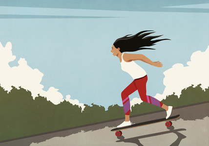 Carefree young woman riding skateboard downhill