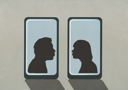 Silhouette couple kissing on separate smart phone screens