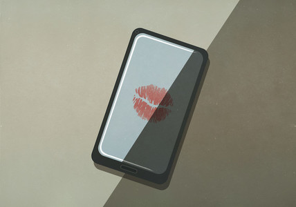 Lipstick kiss on smart phone screen