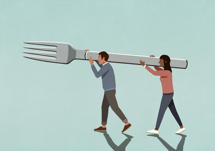 Couple carrying large fork