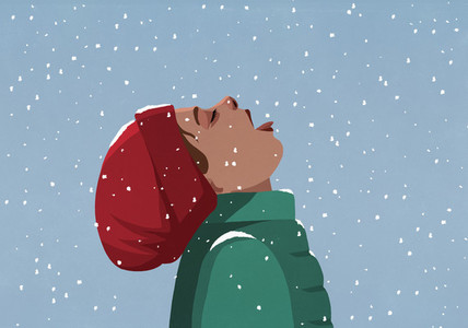 Carefree girl with head back eating falling snow