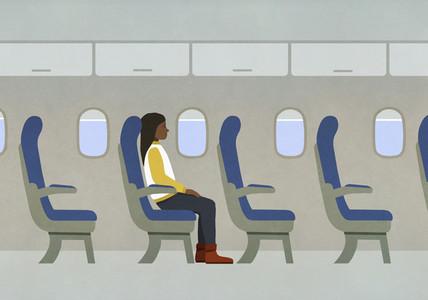 Woman riding airplane alone