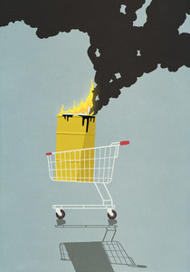 Oil barrel in shopping basket burning on fire
