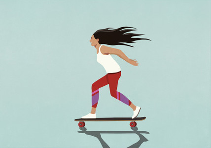 Exhilarated young woman riding skateboard