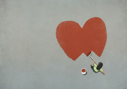 Woman painting red heart with paint roller